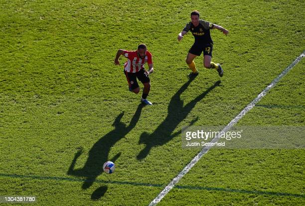 Bryan Mbeumo of Brentford is put under pressure by James Chester of Stoke City during the Sky Bet Championship match between Brentford and Stoke City...