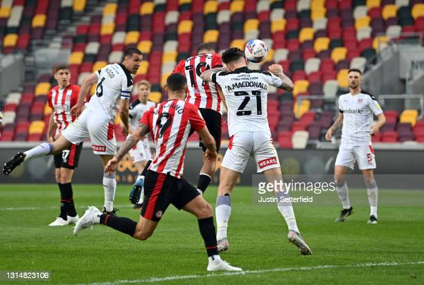 Bryan Mbeumo of Brentford scores their side's first goal whilst under pressure from Angus MacDonald of Rotherham United during the Sky Bet...