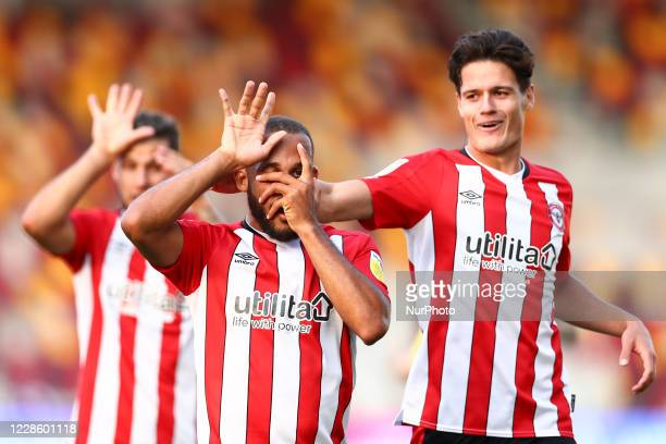 Bryan Mbuemo of Brentford celebrating his teams third goal during the Sky Bet Championship match between Brentford and Huddersfield Town at Griffin...