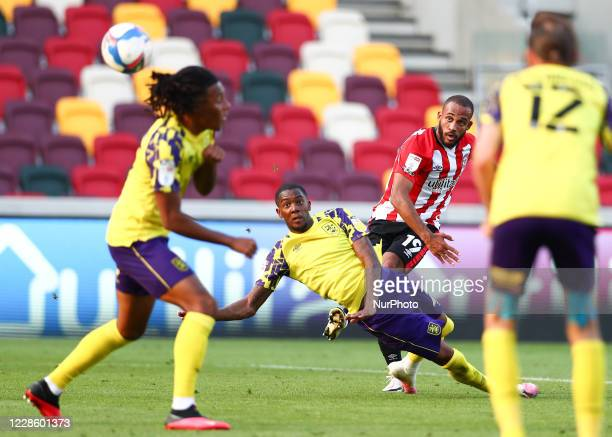 Bryan Mbuemo of Brentford scoring his teams third goal during the Sky Bet Championship match between Brentford and Huddersfield Town at Griffin Park,...