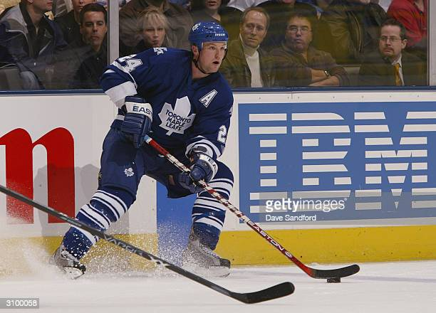 Bryan McCabe of the Toronto Maple Leafs stops and looks to make a play at the blueline against the New York Islanders on March 4 2004 at Air Canada...