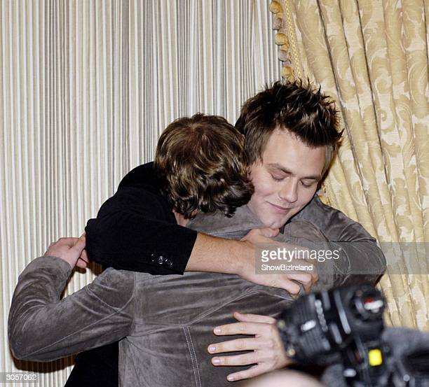 Bryan McFadden hugs Kian Egan as he annouces he is leaving Westlife in The Four Seasons Hotel March 09 in Dublin Ireland