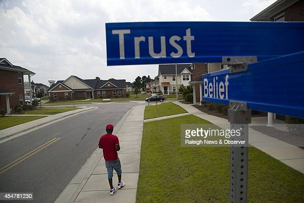 Bryan Melvin walks near the intersection of Trust Drive and Belief Lane at Campbell Terrace affordable housing in east Fayetteville, N.C.