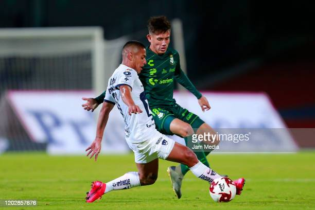 Bryan Mendoza of Pumas fights for the ball with Jonathan Diaz of Santos during the round of 16 match between Pumas UNAM and Santos Laguna as part of...