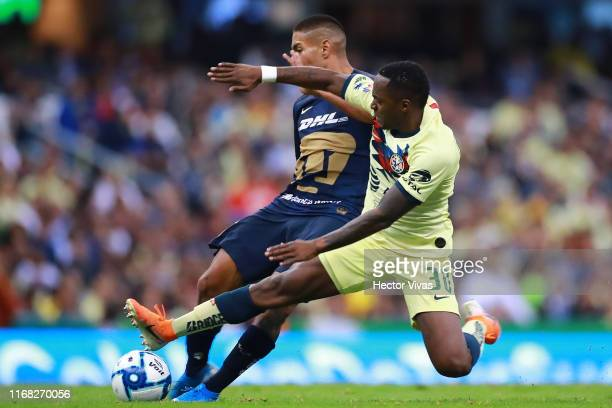 Bryan Mendoza of Pumas scores the first goal of his team against Renato Ibarra of America during the 9th round match between America and Pumas UNAM...
