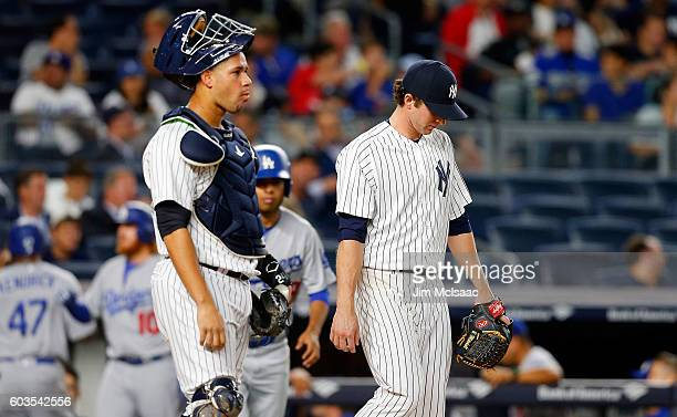 Bryan Mitchell and catcher Gary Sanchez of the New York Yankees look on after two runs scored in the second inning on an error against the Los...