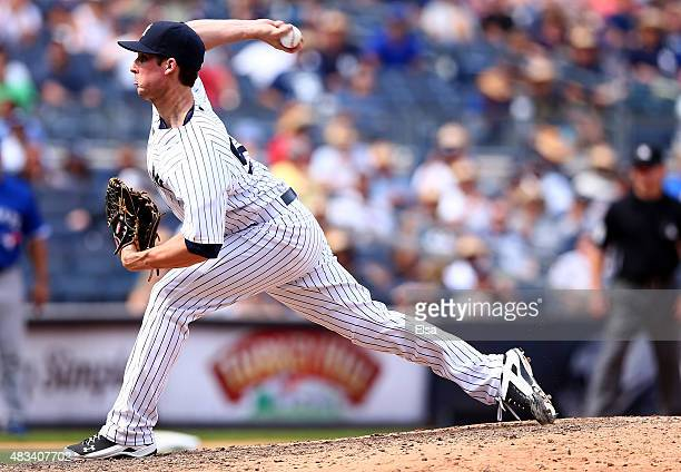 Bryan Mitchell of the New York Yankees delivers a pitch in the eighth inning against the Toronto Blue Jays on August 8 2015 at Yankee Stadium in the...