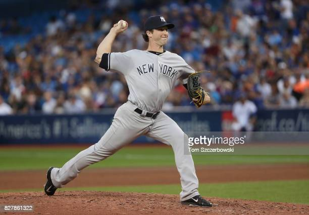 Bryan Mitchell of the New York Yankees delivers a pitch in the fourth inning during MLB game action against the Toronto Blue Jays at Rogers Centre on...