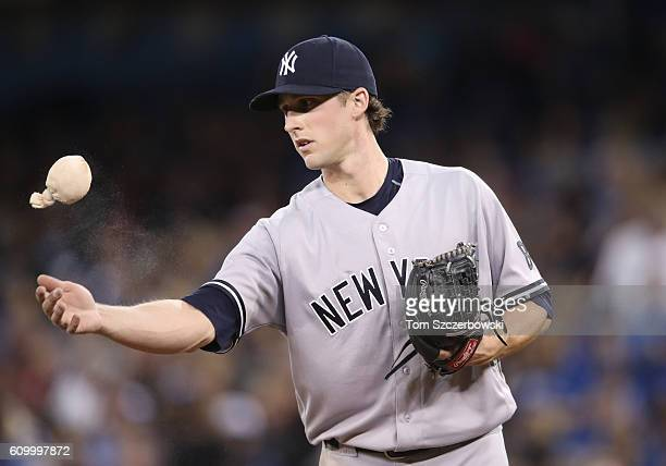 Bryan Mitchell of the New York Yankees goes to the rosin bag in the third inning during MLB game action against the Toronto Blue Jays on September 23...