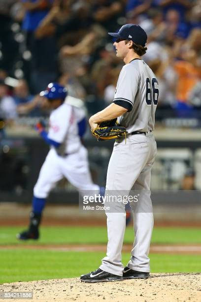 Bryan Mitchell of the New York Yankees stands on the mound as Curtis Granderson of the New York Mets rounds the bases on his grand slam in the ninth...