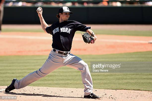 Bryan Mitchell of the New York Yankees throws a pitch during the first inning of a spring training game against the Detroit Tigers at Joker Marchant...