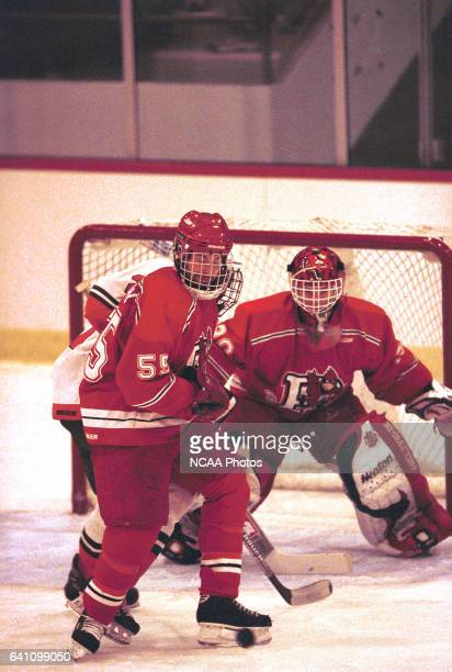 Bryan Murray of Plattsburg State University trys to clear the puck while goalie Niklas Sunberg minds the net during the 2001 NCAA Men's Ice Hockey...