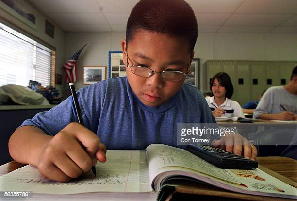 Bryan Nguyen works on a math problem in his eighth grade Algebra 1 class at Fulton Middle School in Fountain Valley Thursday Oct 17 2002 The API test...