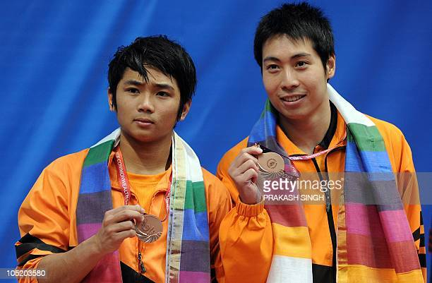 Bryan Nickson Lomas and Ken Nee Yeoh of Malaysia pose during the medal ceremony after winning the bronze in the men's 3m synchro springboard diving...