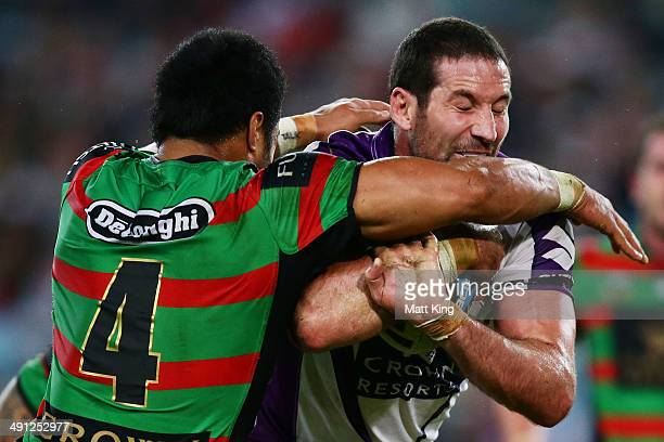 Bryan Norrie of the Storm takes on the defence during the round 10 NRL match between the South Sydney Rabbitohs and the Melbourne Storm at ANZ...