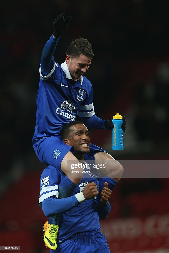 Bryan Oviedo and Sylvain Distin of Everton celebrate after during the Barclays Premier League match between Manchester United and Everton at Old Trafford on December 4, 2013 in Manchester, England.