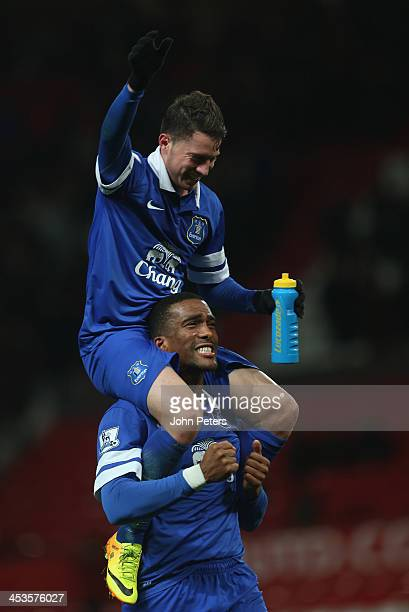 Bryan Oviedo and Sylvain Distin of Everton celebrate after during the Barclays Premier League match between Manchester United and Everton at Old...