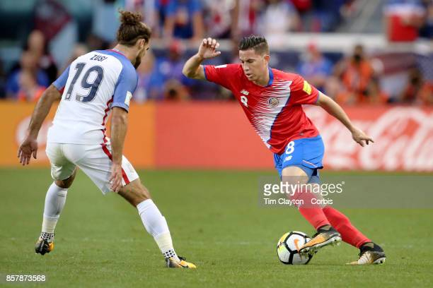 Bryan Oviedo of Costa Rica is challenged by Graham Zusi of the United States during the United States Vs Costa Rica CONCACAF International World Cup...