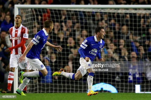 Bryan Oviedo of Everton celebrates after scoring his team's third goal during the Barclays Premier league match between Everton and Stoke City at...