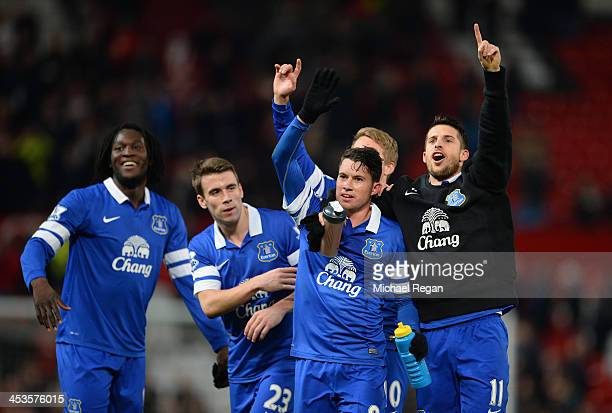 Bryan Oviedo of Everton celebrates with his teammates at the end of the Barclays Premier League match between Manchester United and Everton at Old...