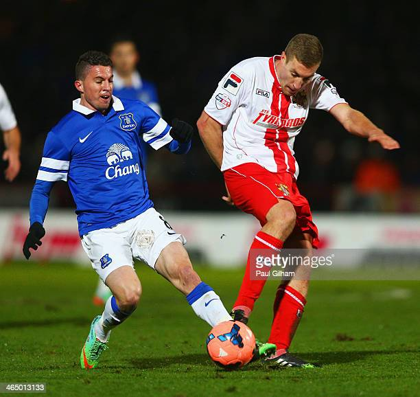 Bryan Oviedo of Everton injures himself challenging Simon Heslop of Stevenage during the Budweiser FA Cup fourth round match between Stevenage and...