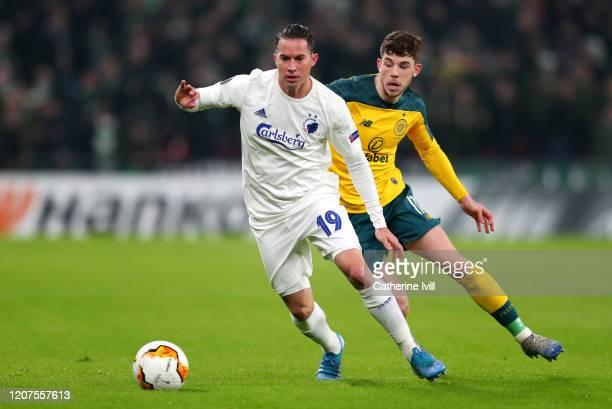 Bryan Oviedo of FC Kobenhavn is challenged by Ryan Christie of Celtic during the UEFA Europa League round of 32 first leg match between FC Kobenhavn...