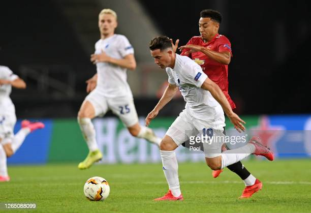 Bryan Oviedo of FC Kobenhavn is put under pressure by Jesse Lingard of Manchester United during the UEFA Europa League Quarter Final between...