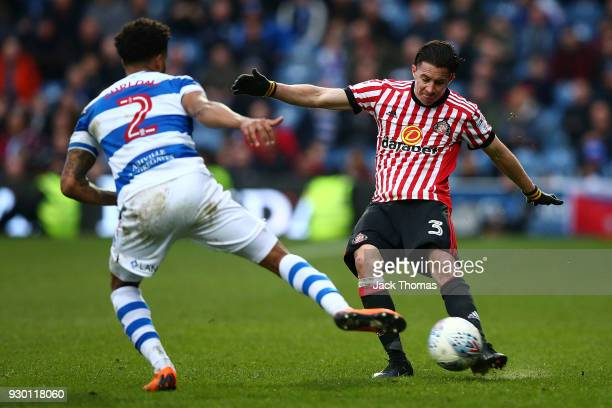 Bryan Oviedo of Sunderland and Darnell Furlong of QPR in action during the Sky Bet Championship match between Queens Park Rangers and Sunderland at...