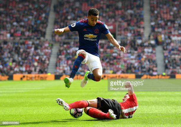 Bryan Oviedo of Sunderland challenges Jesse Lingard of Manchester United during the Premier League match between Sunderland and Manchester United at...