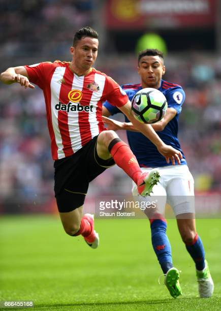 Bryan Oviedo of Sunderland is closed down by Jesse Lingard of Manchester United during the Premier League match between Sunderland and Manchester...