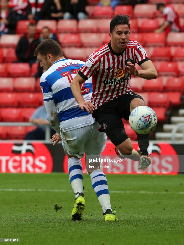 Bryan Oviedo of Sunderland (R) is fouled by Jamie Makie of QPR during the Sky Bet Championship match between Sunderland and Queens Park Rangers at Stadium of Light on October 14, 2017 in Sunderland, England.