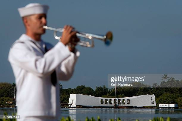 Bryan Parmann plays Taps in front of the USS Arizona Memorial on the 69th anniversary of the attack on the US naval base at Pearl Harbor on the...