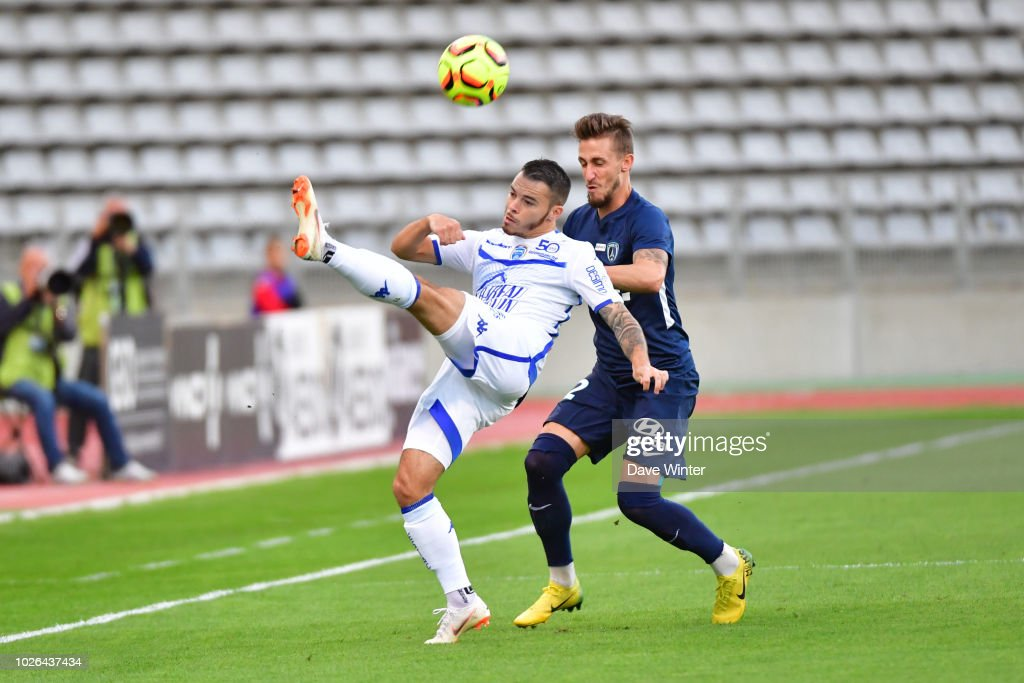 cc12f28f2840 Bryan Pele of Troyes and Vincent Rufli of Paris FC during the French ...