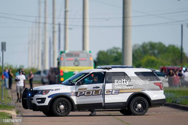 Bryan police officer blocks road access near the scene of a mass shooting at an industrial park in Bryan in Bryan, Texas on April 8, 2021. - One...