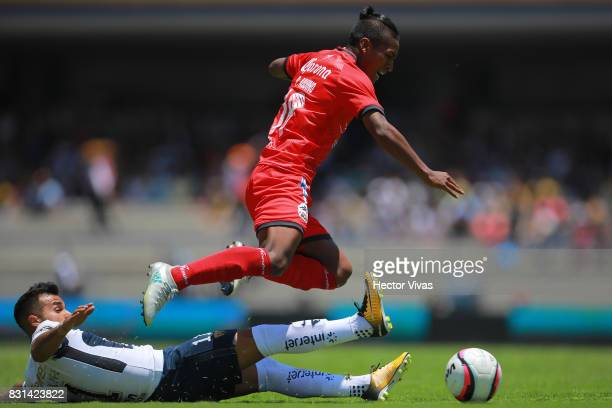 Bryan Rabello of Pumas struggles for the ball with Pedro Aquino of Lobos BUAP during the fourth round match between Pumas UNAM and Lobos BUAP as part...