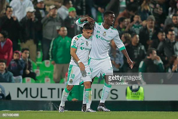 Bryan Rabello of Santos celebrates with teammate Djaniny Tavares after scoring the first goal of his team during the fourth round match between...
