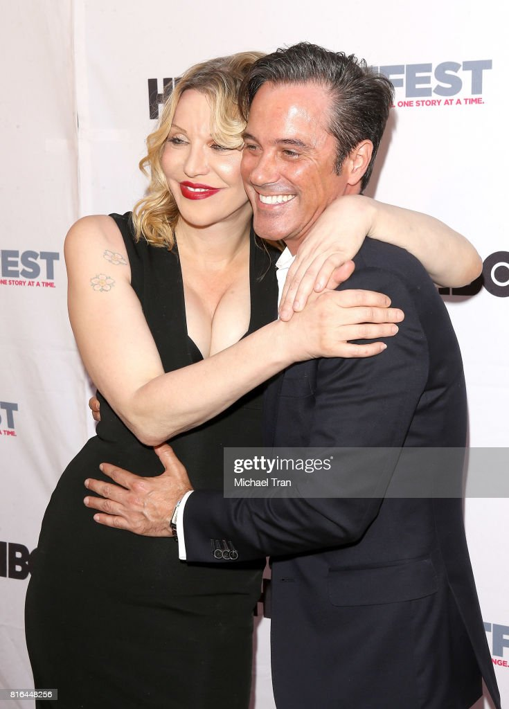 Bryan Rabin (R) and Courtney Love arrive at the 2017 Outfest Los Angeles LGBT Film Festival - closing night gala screening of 'Freak Show' held at The Theatre at Ace Hotel on July 16, 2017 in Los Angeles, California.