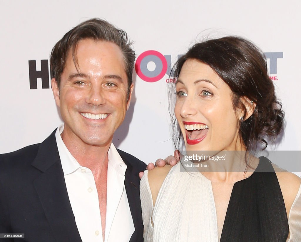 Bryan Rabin (L) and Lisa Edelstein arrive at the 2017 Outfest Los Angeles LGBT Film Festival - closing night gala screening of 'Freak Show' held at The Theatre at Ace Hotel on July 16, 2017 in Los Angeles, California.