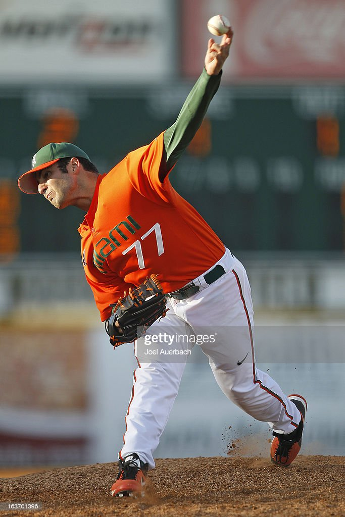 Bryan Radziewski #77 of the Miami Hurricanes throws the ball against the Illinois State Redbirds on March 13, 2013 at Alex Rodriguez Park at Mark Light Field in Coral Gables, Florida. The Hurricanes defeated the Redbirds 9-2.