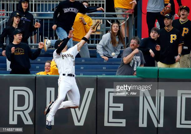 Bryan Reynolds of the Pittsburgh Pirates can't make the catch in the third inning against the Colorado Rockies at PNC Park on May 21, 2019 in...