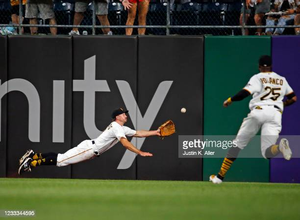 Bryan Reynolds of the Pittsburgh Pirates is unable to make the catch in the fifth inning on an RBI triple against the Los Angeles Dodgers at PNC Park...