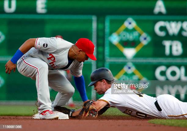 Bryan Reynolds of the Pittsburgh Pirates steals second in the first inning against Cesar Hernandez of the Philadelphia Phillies at PNC Park on July...