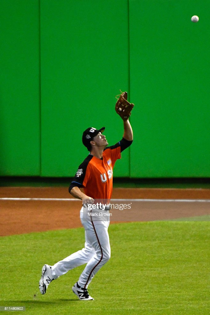 Bryan Reynolds #11 of the San Francisco Giants and the U.S. Team fields a ball prior to the SiriusXM All-Star Futures Game at Marlins Park on July 9, 2017 in Miami, Florida.
