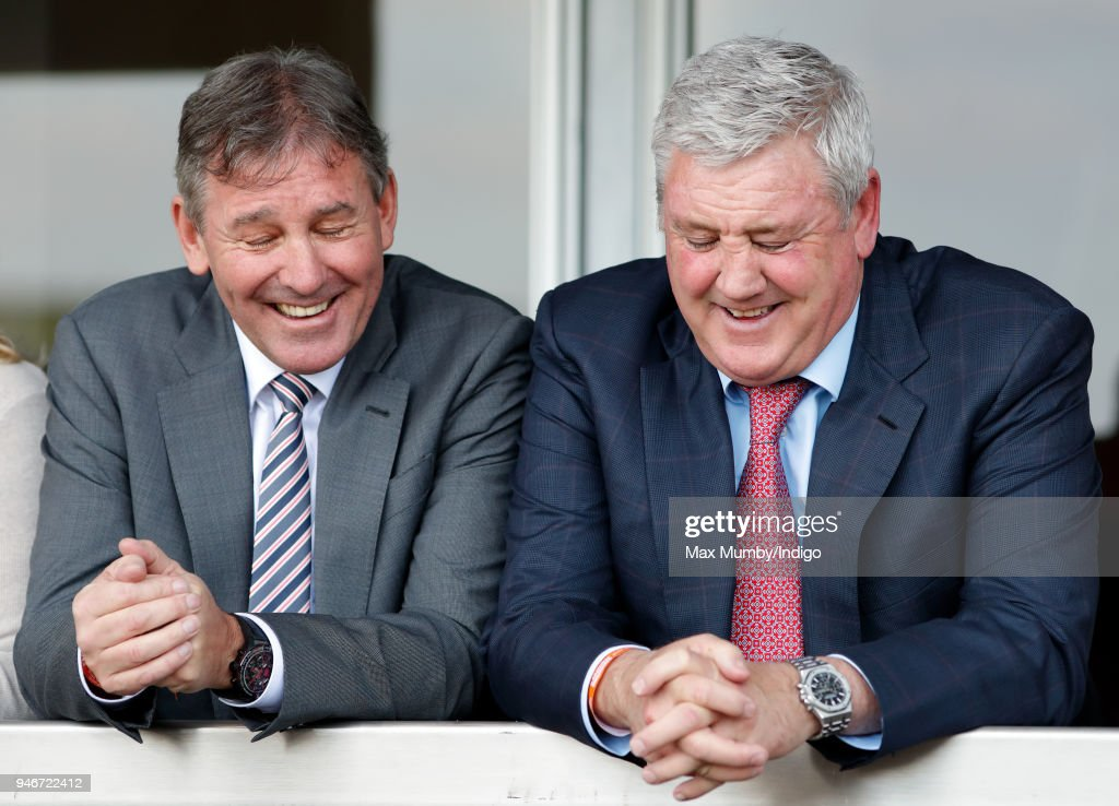 Bryan Robson and Steve Bruce watch the racing as they attend day three 'Grand National Day' of The Randox Health Grand National Festival at Aintree Racecourse on April 14, 2018 in Liverpool, England.