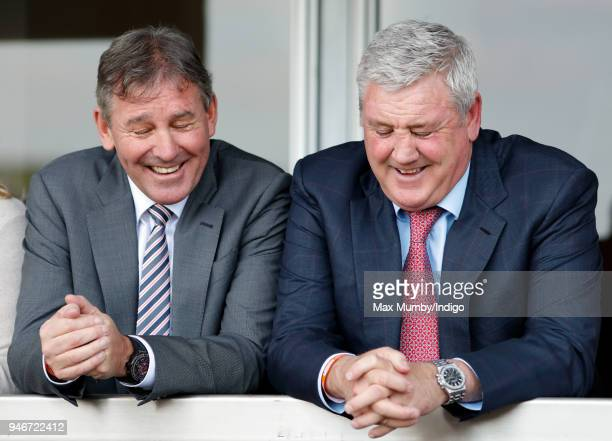 Bryan Robson and Steve Bruce watch the racing as they attend day three 'Grand National Day' of The Randox Health Grand National Festival at Aintree...