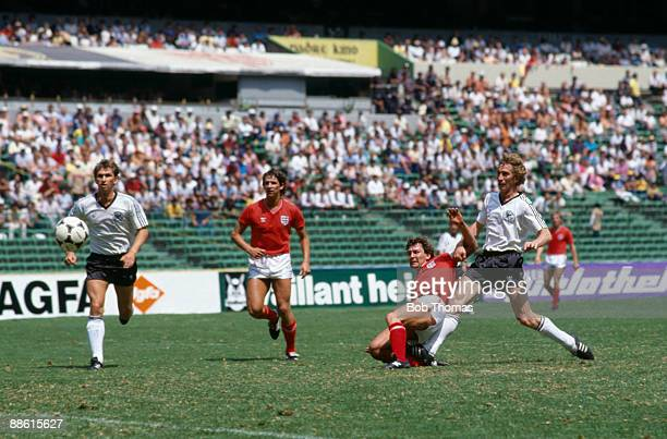 Bryan Robson beats German defender Ditmar Jakobs to score England's first goal during their 30 victory at the Azteca Stadium in Mexico City 12th June...