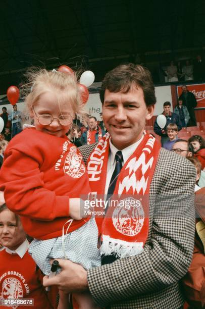 Bryan Robson being unveiled as the new Manager for Middlesbrough FC Pictured holding a young fan Ayresome Park Middlesbrough 18th May 1994