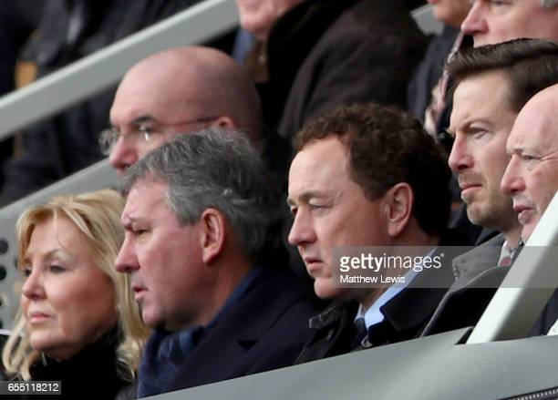 Bryan Robson, ex Middlesbrough player and Steve Gibson, Middlesbrough chairman look on from the stands during the Premier League match between...