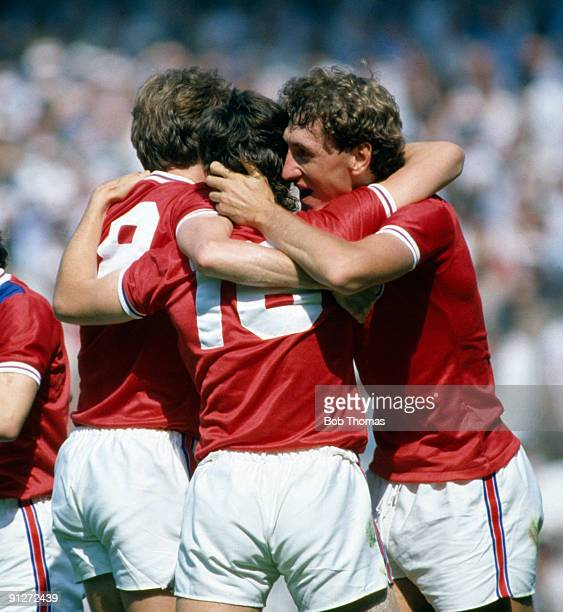 Bryan Robson of England is congratulated by teammates after scoring a goal during the England v France World Cup match played in Bilbao Spain on the...