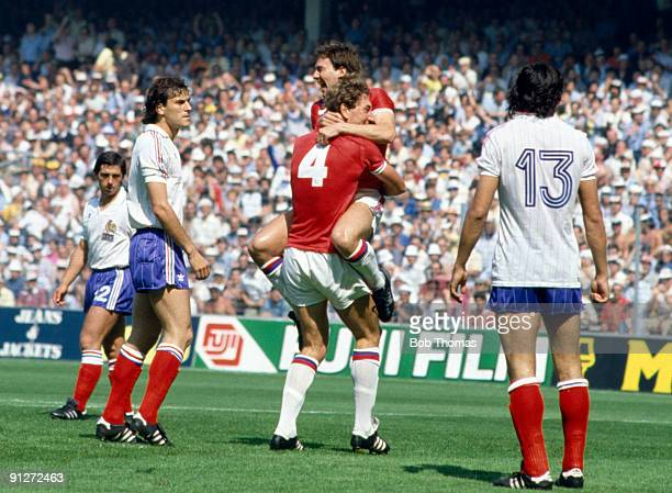 Bryan Robson of England is lifted off the ground by teammate Terry Butcher after scoring a goal within the first 30 seconds of the England v France...